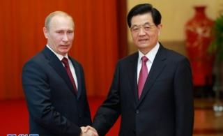胡锦涛抵俄出席APEC峰会