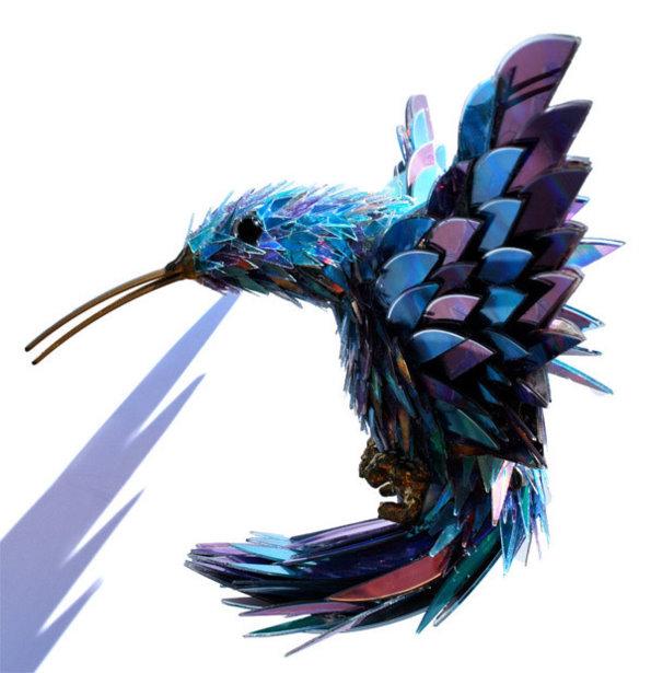 使用废旧光盘制作的可爱的动物雕塑