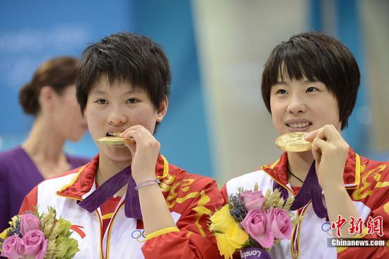 [讨论]奥运趣事集锦:运动员为何爱咬奖牌