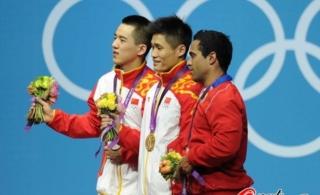 吕小军:金牌得来不易陆浩杰:带伤上阵争口气