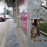 碧江便水门候车亭墙面被损坏 希望恢复原貌