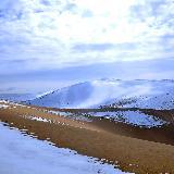 瓜州摄影师在敦煌—鸣沙山清明时节雪纷纷[原创]