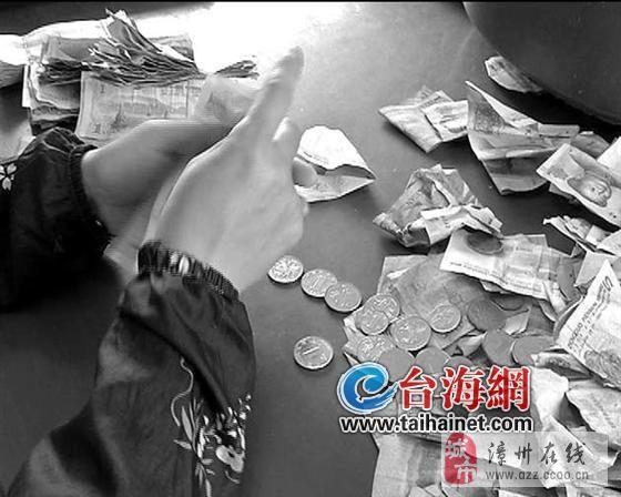 漳浦公交有点头疼:5年收到假残币2万多元