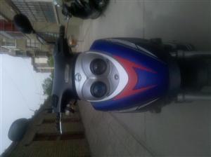 轻骑木兰125踏板车图片