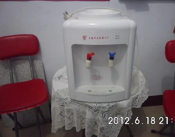 出售二手好质量饮水机一台、美的小型台式电风扇一台
