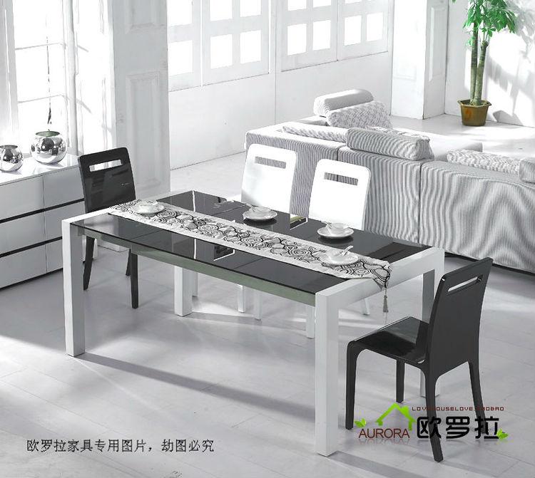 全新刚刚购置黑色钢化玻璃白色桌腿时尚可拉伸餐桌