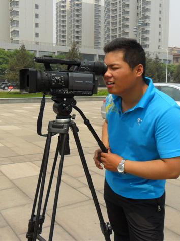 李万,摄像师